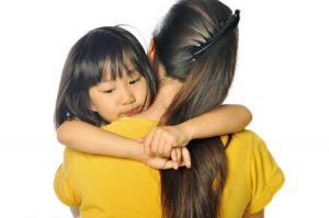 Anxious Child Hugging Mother